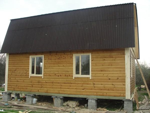 Каркасный дом на опорно-столбчатом фундаменте из ФБС